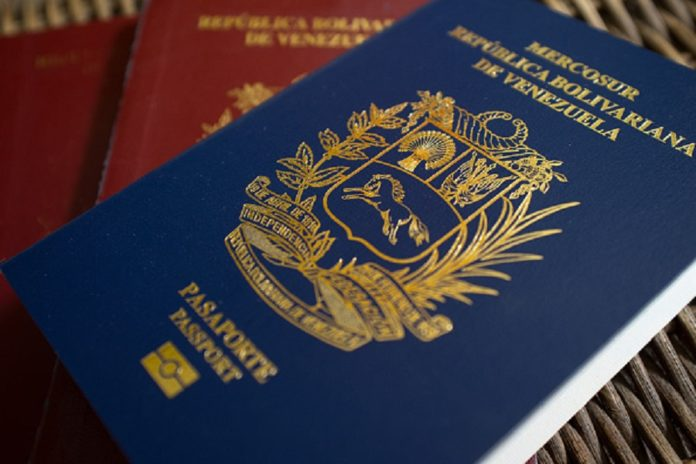 """The blue Mercosur Venezuelan passport is displayed for a photograph in Caracas, Venezuela, on Thursday, Feb. 23, 2017. Of all the shortages that plague Venezuela today -- of food and medicine, even money -- the lack of passports is in some ways the cruelest. The reason the passport agency, known as Saime, has given for the shortfall is that it doesn't have enough """"materials."""" Photographer: Manaure Quintero/Bloomberg via Getty Images"""