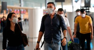 People wear protective face masks as a preventive measure against the spread of the new Coronavirus, COVID-19, at El Dorado airport in Bogota on March 7, 2020. (Photo by Raul ARBOLEDA / AFP) (Photo by RAUL ARBOLEDA/AFP via Getty Images)