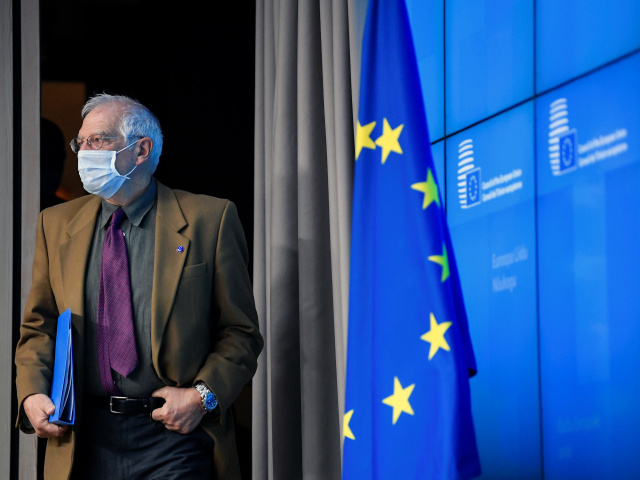 Josep Borrell, EU High Representative for Foreign Affairs and Security Policy, wearing a protective mask arrives for a news conference after a European Union Foreign Ministers meeting in Brussels, Belgium December 7, 2020.           John Thys/Pool via REUTERS