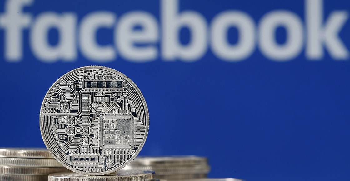 "PARIS, FRANCE - JUNE 18: In this photo illustration, a visual representation of a digital cryptocurrency coin sits on display in front of a Facebook logo on June 17, 2019 in Paris, France. Facebook will announce Tuesday, June 18 the details of its cryptocurrency, called "" Libra "". Like bitcoin, the best-known virtual currency, it will rely on blockchain technology. This universal currency must allow its users to buy products or services from the Facebook universe, which also owns Messenger, Instagram and WhatsApp. It will also be possible to transfer ""Libras"" between individuals. Several companies like Visa, MasterCard, PayPal and Uber have already joined the consortium created by Facebook. (Photo by Chesnot/Getty Images)"