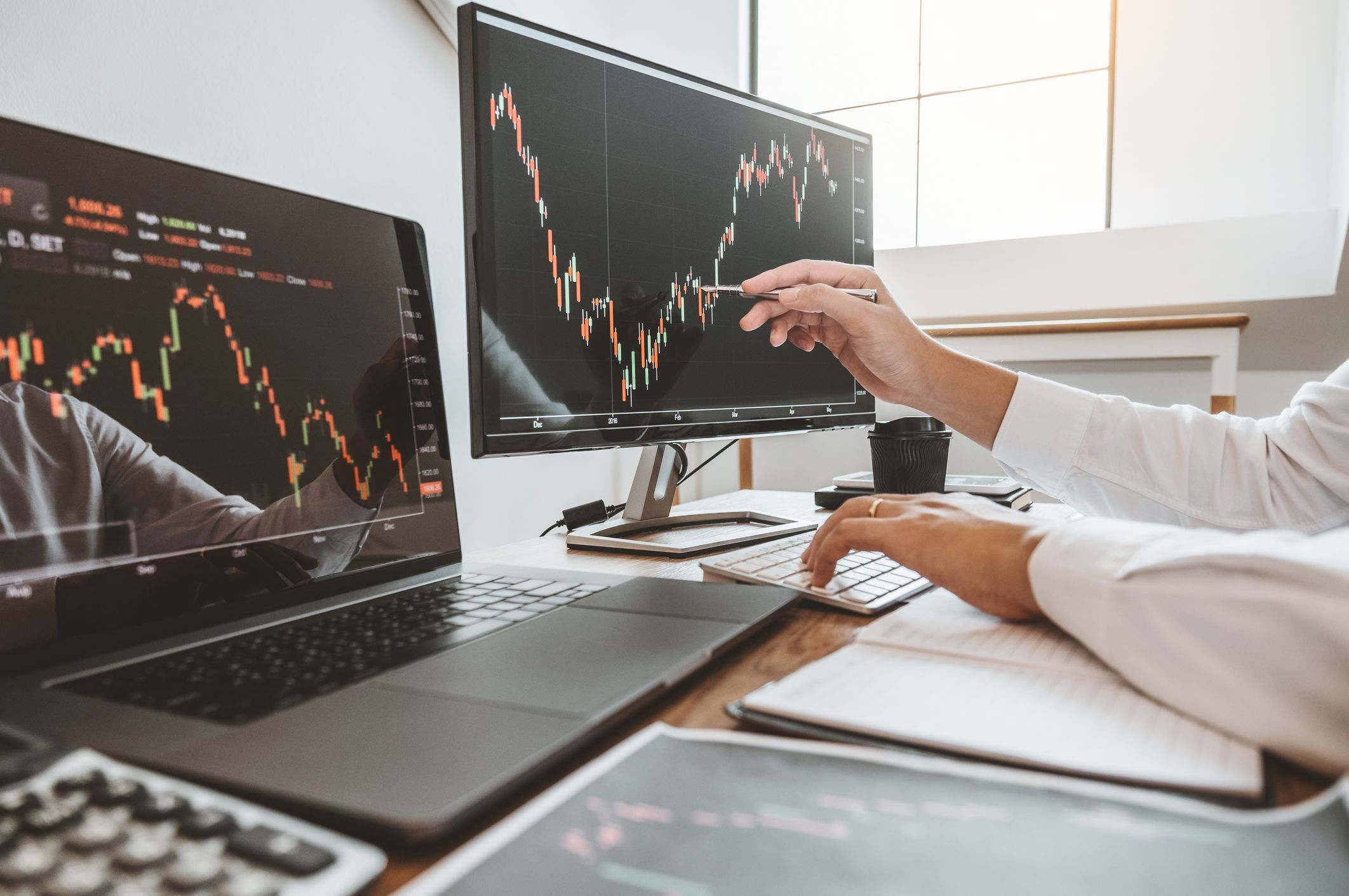 Investment stock market Entrepreneur Business team discussing and analysis graph stock market trading,stock chart concept